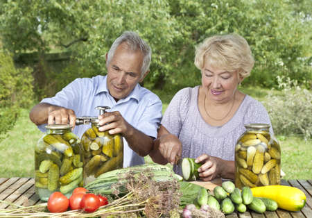 Mature couple making home made pickles  photo