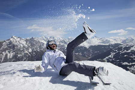Happy female skier playing in snow outdoor photo