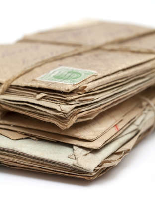 Stack of old letters, over white background. Air mail, postcards and typed letters photo
