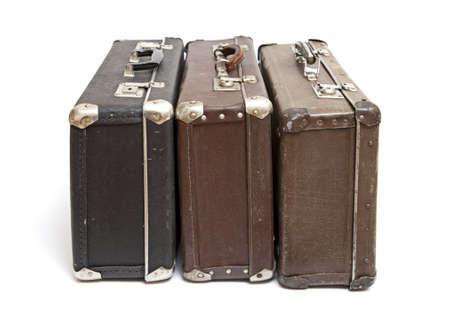 白い背景上に分離されて古い旅行荷物 写真素材