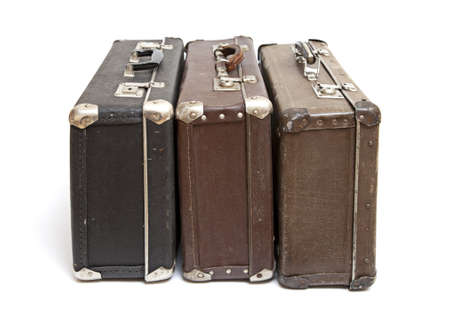 Old travelling luggage isolated on a white background photo