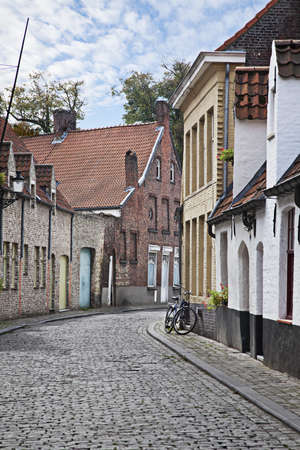 cobblestone street: Cityscape of Bruges streets with bicycle, Belgium.  Stock Photo