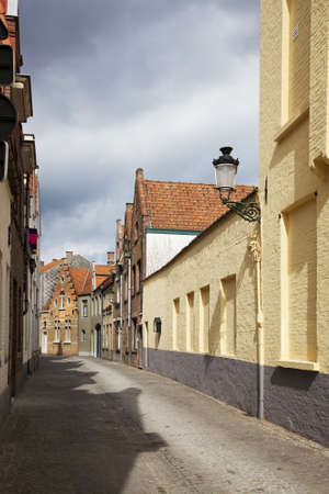 A typical narrow streets of Brugge, Belgium photo