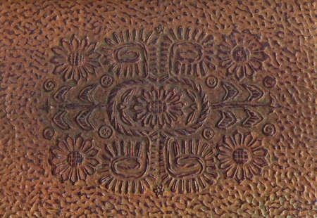 embossed: Embossed brown book cover  (scan)