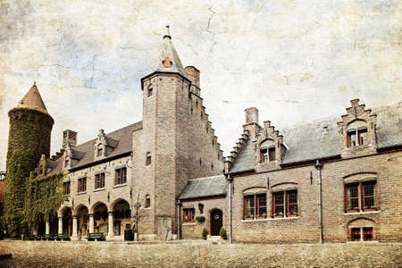 made in belgium: View of medieval castle in Bruges, Belgium. Made in artistic vintage style with texture
