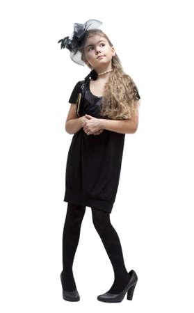 niños vistiendose: Ocho años en los zapatos de niña de su madre. Aislado en blanco Foto de archivo