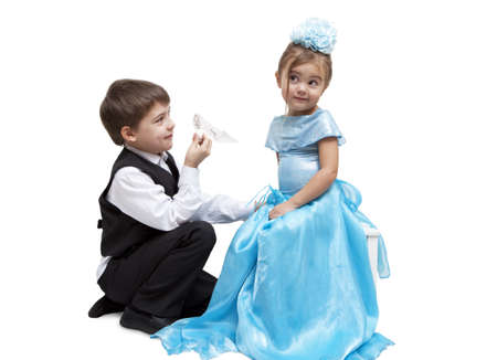 Little boy give a glass slipper to little girl