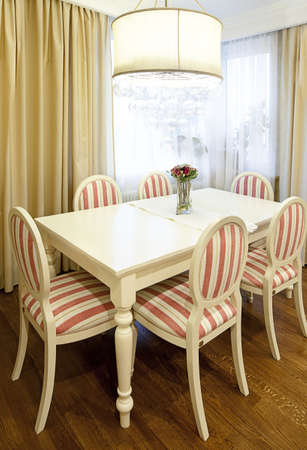 dining table and chairs: Interior shot of a modern dining room in sunlight Stock Photo