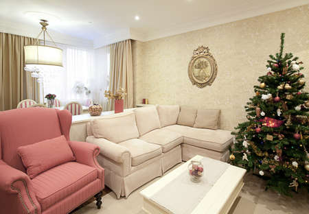 Interior shot of a modern living room with a Christmas tree photo