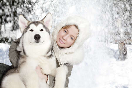 Five month old malamute puppy with young woman Stock Photo - 13048032
