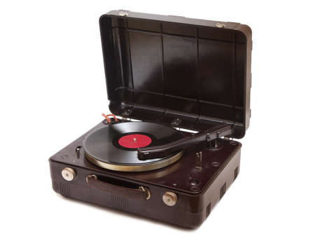 Retro portable turntable with vinyl record isolated on white photo