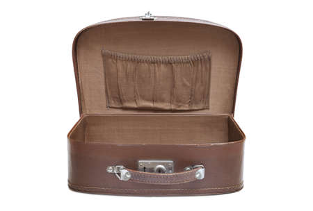 Open empty vintage suitcase isolated on white background photo