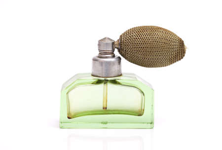 Studio shot of a vintage perfume bottle isolated on white photo