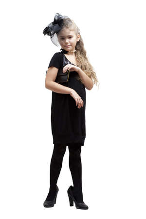 oversized: Eight years old girl in her mothers shoes over white