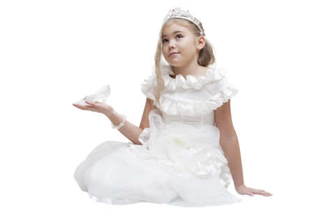 Beautiful young princess waiting for her prince. Isolated on white photo
