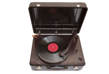 Vintage record player with vinyl record over white photo