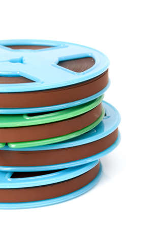 Stack of old magnetic tapes on white background photo
