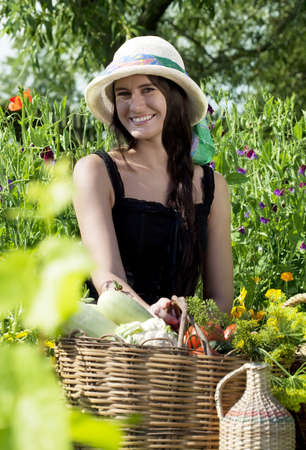 demijohn: Caucasian young woman in a hat in the garden