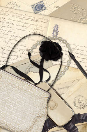 Collage with antique letters, old envelopes, reticule and necklace photo