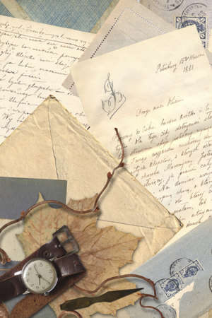 Collage with antique letters, old envelopes, watch and dry leaf photo