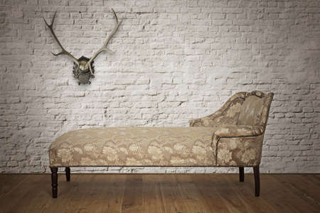 Antique couch from Victorian era with horns on the wall Stock Photo - 17457490