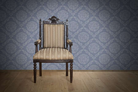 Single Old Antique armchair from Victorian era Near The Wall Stock Photo - 17418528