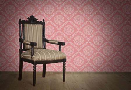 Old Antique armchair from Victorian era Near The Wall Stock Photo - 17418527