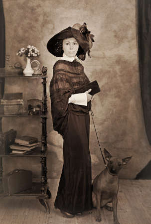 intentional: Portrait of woman with a dog. Intentional 1900s style post processing emulation.