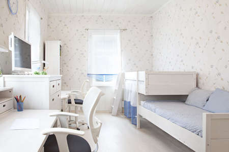 Modern interior of kids bedroom in sunlight