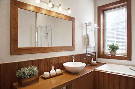 Modern Residential Home Bathroom with large mirror Archivio Fotografico