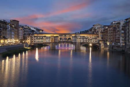 ponte vecchio: Ponte Vecchio stone bridge at sunset. Florence, Italy  Stock Photo