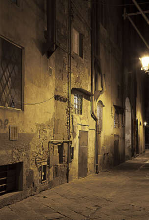Ancient alleyway in Pisa  Tuscany, Italy  at night