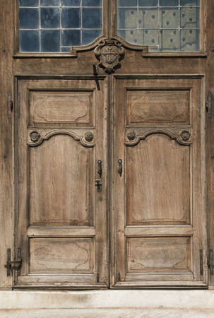 close up image: Italian typical architecture   An old, rusty wooden door with lot of scratches Stock Photo