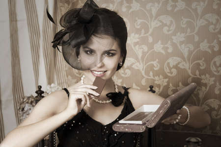 Portrait of beauty young woman with chocolate  Emulations of vintage style photography photo