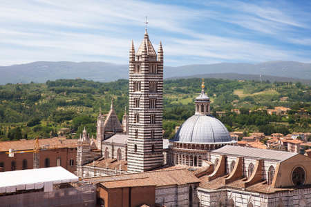 siena italy: Duomo of Siena, Tuscany, Italy  Siena cathedral against a bright blue sky