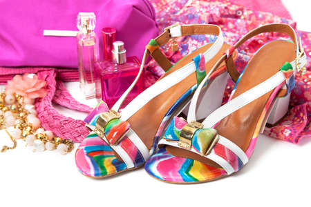 fetishes: Female accessories with shoes and perfume over white Stock Photo
