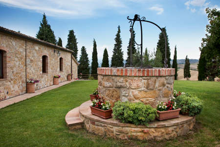 drinkable: Courtyard with artesian well of drinkable water Stock Photo