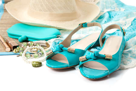 fetishes: Female accessories with turquoise shoes isolated on white