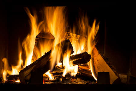 Burning Wood In The Fireplace at home photo