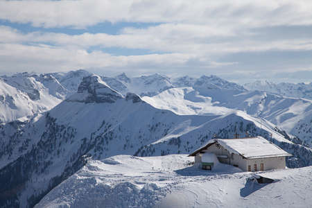 fassa: Lonely house in the Alps in winter landscape of the Dolomites