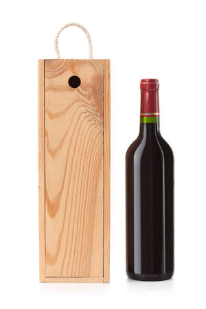 Wooden case with wine bottle isolated on white  photo
