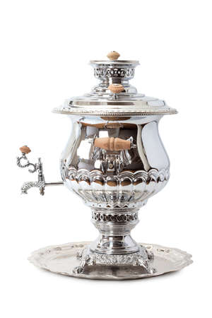 Traditional tea samovar on a tray isolated on white background  photo