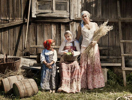 peasant: Retro styled photo of mother with two daughters  Stock Photo
