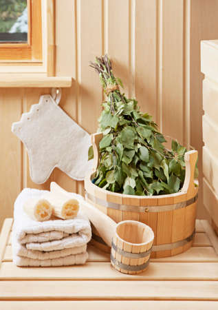 Detail of sauna interior with traditional sauna accessories  Stock Photo