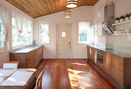 roomy: Interior of a roomy dining room in sunlight