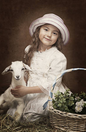 yeanling: Vintage styled portrait of a little girl with a baby goat