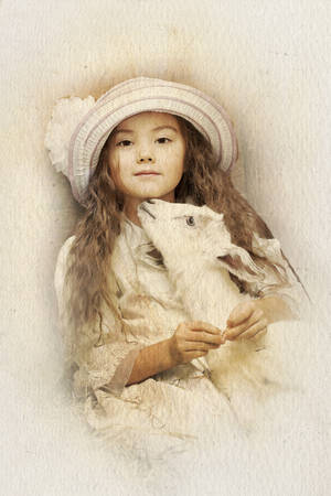 emulation: A little girl and pet goat. Intentional 1900s style post processing emulation. Stock Photo