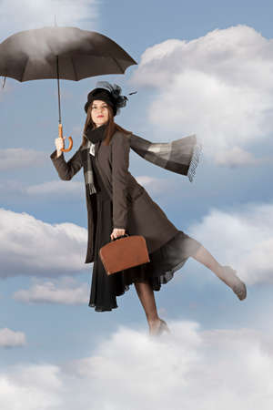 Picture with Mary Poppins flies on an umbrella