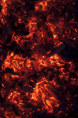 embers: Full frame shot of glowing embers in hot red color Stock Photo