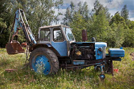 neglected: Neglected old farm tractor, rusty and broken Stock Photo